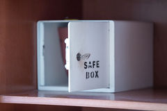 Simple safe box with key Royalty Free Stock Image
