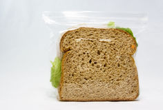 Simple Sandwich. Simple, basic sandwich with lettuce sealed inside a plastic bag Royalty Free Stock Photography