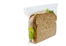 Simple Sandwich. Side and fron view of simple, basic sandwich with lettuce sealed inside a plastic bag Stock Photos