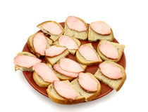 Simple sandwiches. Plate of simple sandwiches with ham Stock Images