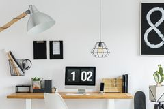 Simple scandinavian study corner. With white wall and black accents Stock Images