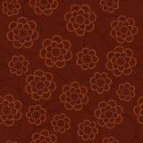 Simple schematic flowers on a dark brown background. Floral seam Royalty Free Stock Photos