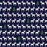 Simple seamless Christmas pattern - deers, xmas trees. Stock Photography