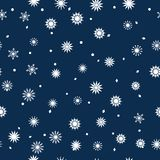 Simple seamless pattern of snowflakes on a dark blue background. Abstract wallpaper, wrapping decoration. Symbol of Royalty Free Stock Photo