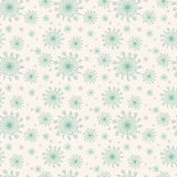 Simple seamless pattern with spring flowers. Ornament with dandelions in mint and beige color. Floral seamless background for dres Royalty Free Stock Photo