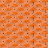 Simple seamless pattern with umbrellas. Simple seamless pattern with orange umbrellas Royalty Free Stock Photos