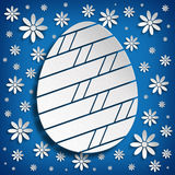 Simple shape of Easter egg on blue background Royalty Free Stock Photography