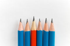 Simple sharp pencils isolated on white background, red among blue Stock Image