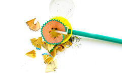 A simple sharpened pencil with peelings. On a white background closeup Stock Images