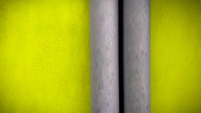 FLOURESCENT GREEN WALL AND GREY PIPE royalty free stock photo
