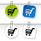 Simple shopping cart - trolley on green, blue and white stickers. Rounded and square labels. Item, buy button for web page. Stock Photo