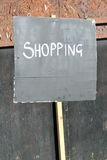 Simple shopping sign. On blackboard Stock Image