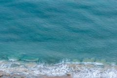 Simple shot of the sea and the waves crashing on the beach. Royalty Free Stock Photography