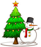 A simple sketch of a snowman beside the Christmas tree Stock Photos