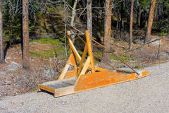 A simple sled pulled by ski-doos in the winter Royalty Free Stock Image