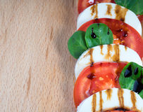 Simple snack canape with tomato, mozzarella and basil Royalty Free Stock Photography