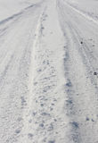 Simple snow car tracks. Simply composed car tracks in snow - portrait. Suitable as a travel image to a remote location stock photos