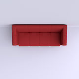 Simple sofa in the corner of the room. Stock Photography