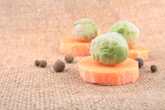 Simple still life with carrot and Brussels sprout Royalty Free Stock Photo