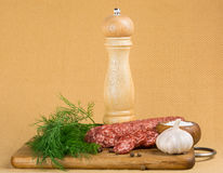Simple still life with cut sausage Stock Image
