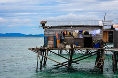 Simple stilt house at Mabul Island. May 5 2011 - Mabul Island, Malaysia - The Sama-Bajau have been a nomadic, seafaring people, living off the sea by trading and Royalty Free Stock Image