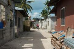 Simple street in african village. ZANZIBAR, TANZANIYA- JULY 13: simple street in african village on July 13, 2016 in Zanzibar, Tanzania Royalty Free Stock Photography