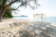 Simple style wedding arch and decoration, venue, setup on tropic. Al beach, outdoor beach wedding Stock Images