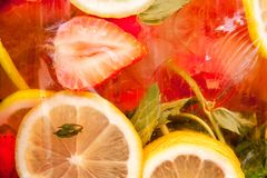 Simple summer saturation lemon strawberry cocktail with lime, le. Summer yellow simple lemon strawberry organic freshness lemonade drink with Ice and fruit and stock photos