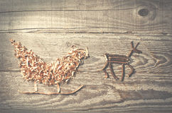Simple symbols of Father Christmas sleigh arranged from sawdust Royalty Free Stock Image