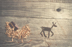 Simple symbols of Father Christmas sleigh arranged from sawdust Stock Photo