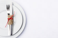 Simple table setting with burlap and ribbon on white plates Royalty Free Stock Image