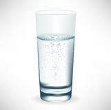 Simple tall glass of mineral water Royalty Free Stock Photo