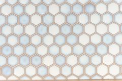 A simple white texture pattern. Of hexagons as a background stock photos