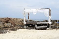 Simple timber beach shack with white shade on the rock beach. In Phuket, Thailand Stock Images