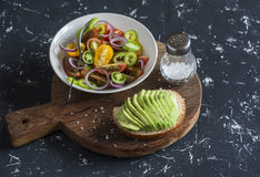 Simple tomato salad and avocado sandwich. Stock Photo