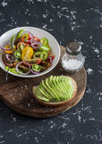 Simple tomato salad and avocado sandwich. Royalty Free Stock Image