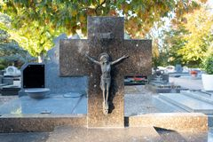 Tombstone with a crucifix in a cemetary royalty free stock image