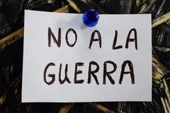 Simple and understandable inscription, no war in Spanish. No a la guerra written in Spanish, means to not to the war, on a white sheet of paper stock photos