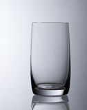 Simple understated empty water glass Royalty Free Stock Photos
