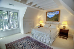 Simple upstairs bedroom stock images