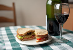 Simple vegetarian sandwich with a glass of wine Royalty Free Stock Photography
