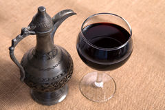 Simple View Of Pewter Flagon and Red Vine in the Glass Royalty Free Stock Image