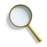 Simple vintage brass magnifying glass isolated Stock Image