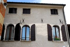 Simple wall of a building with six windows in Portobuffolè in the province of Treviso in the Veneto (Italy) Stock Images