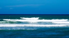 Simple waves from the Atlantic Ocean. Simple waves near a beach with a view of the Atlantic Ocean. Puerto Plata, Dominican Republic royalty free stock photos