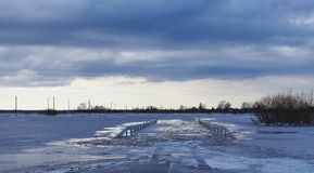 Road and fields in flood, Lithuania Royalty Free Stock Images