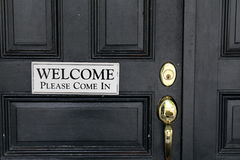 Simple welcome sign on black door Royalty Free Stock Images