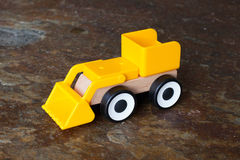Simple wheel dozer toy Royalty Free Stock Photos