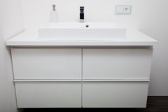 Simple white bathroom cabinet and hand basin Royalty Free Stock Images