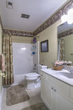 Simple white bathroom with tub. Simple dated bathroom with tub surround Royalty Free Stock Images